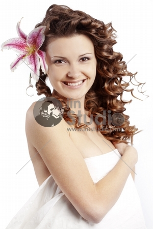 Portrait of very cute young woman with healthy curly hair