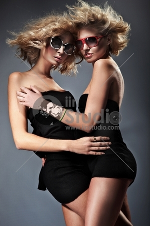 Two blond women wearing sunglasses