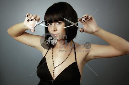 beautiful girl with scissors