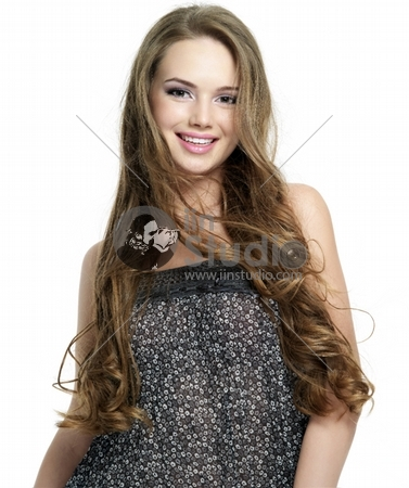 Happy smiling young woman with beautiful long hair - white background. Fashion model