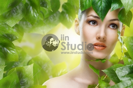 a beauty girl on the leaves background