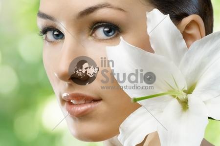 beauty flower girl on the green background