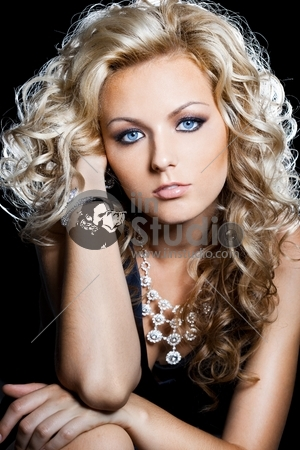 beautiful fashionable woman on black background