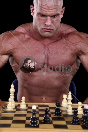 Bodybuilder Playing Chess
