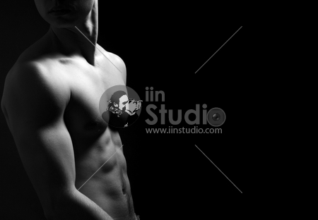 B&W young sporty man over black background