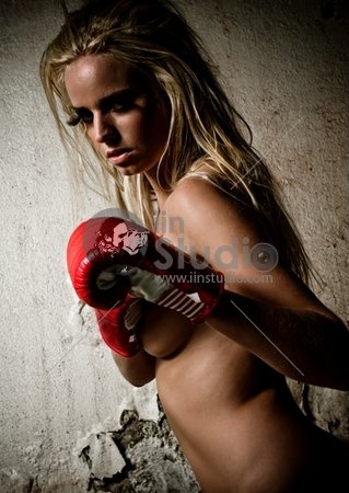Boxer Girl Posing With Red Boxer Gloves