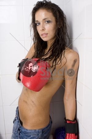 Beautiful topless glamour woman with red boxing gloves