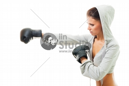 Conident strong woman hit the goal with right hand, boxing, profile view,isolated