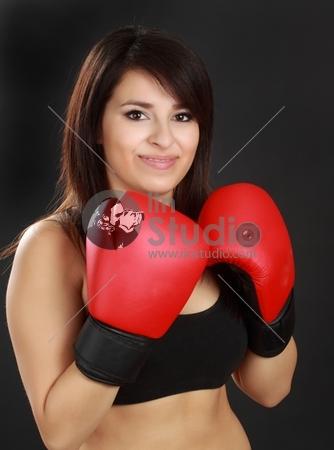 beautiful hispanic woman wearing red boxing glove