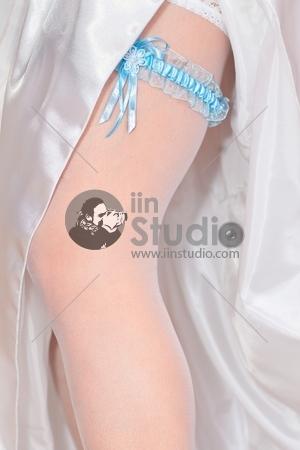 Beautiful wedding garter on leg