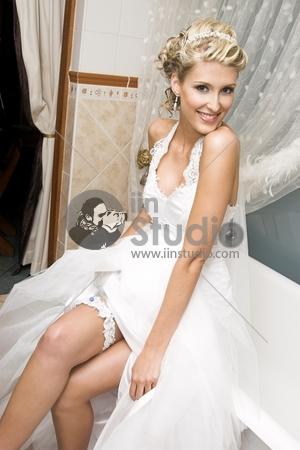 Beautiful Blond Bride Wearing Diamond Jewelery And Tiara