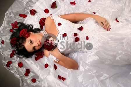 sexy young bride with red roses