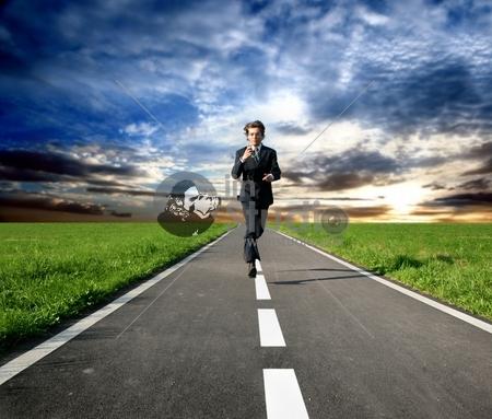 a business man run on the street