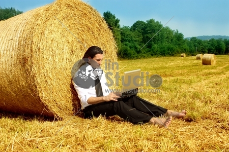 a business man in a countryside with a laptop