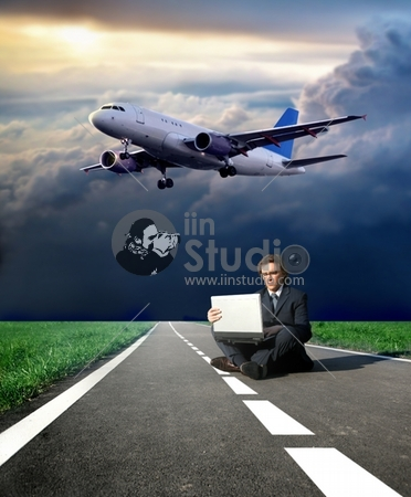 a business man on the street and a airplane