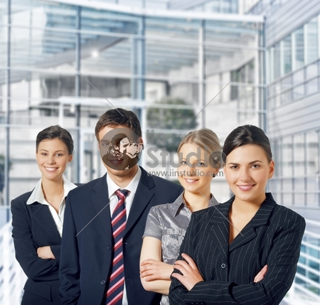 Young And Successful Businessteam Standing In A Corridoor Of A Modern Office