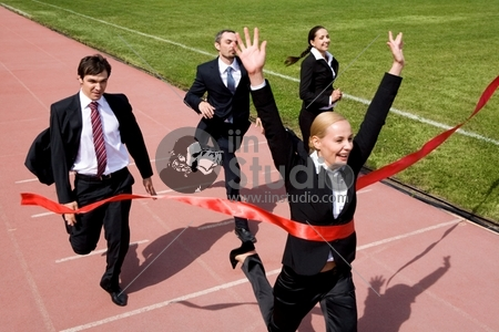 Photo of businesspeople crossing the finish line