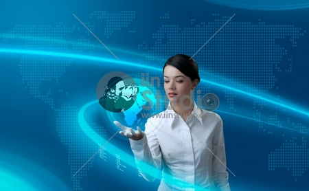 Attractive brunette holding virtual globe (outstanding business people in interiors / interfaces series)