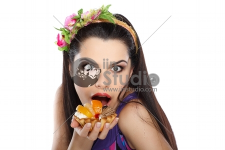 young, beautiful brunette with fruit cake