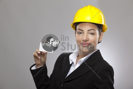 Female architect holding business card