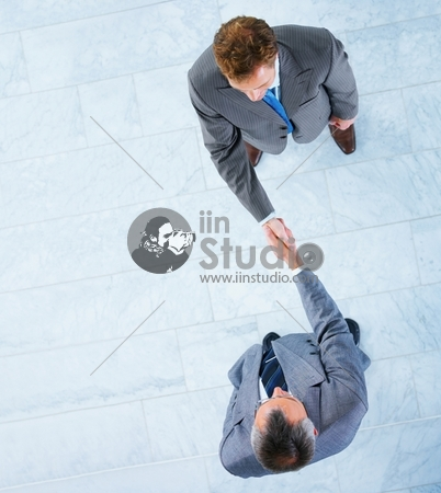 Business Handshake And Trust Taken From Above, With Lots Of Copyspace To The Left