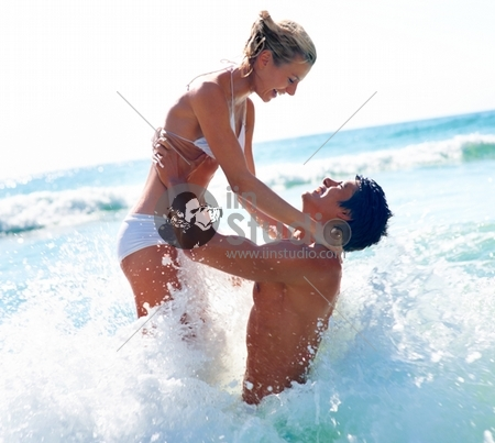 Portrait Of Happy Couple Having Good Time On The Beach