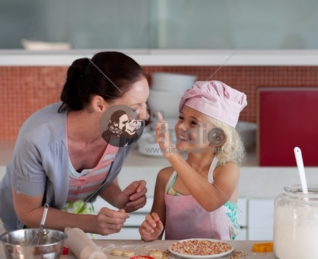 Potrait of money and Daugther having fun together in Kitchen