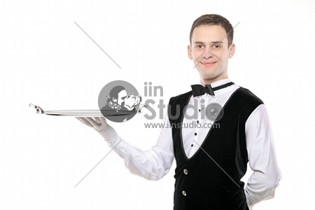 A butler holding an empty silver tray isolated on white background