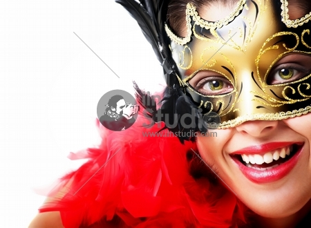 Beautiful young woman in carnival mask and feather boa. Isolated on white background.