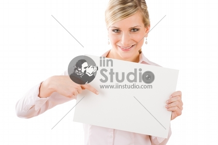 Happy businesswoman pointing front at blank advertising banner on white