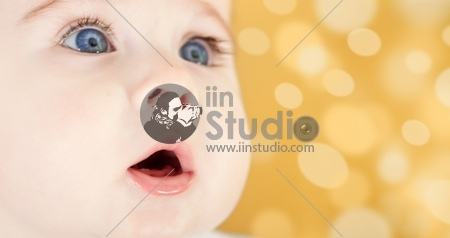Portrait of adorable blue-eyes baby. Face close-up