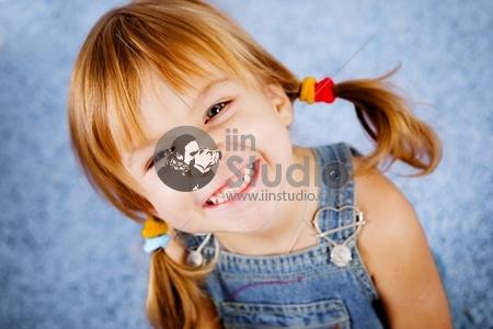 Funny playful little girl on blue