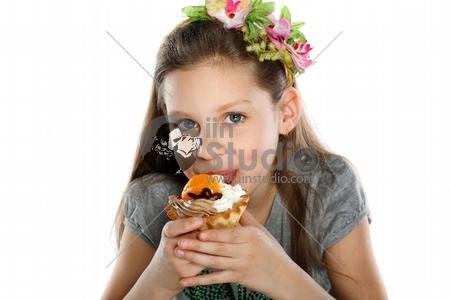 happy child with fruit cake