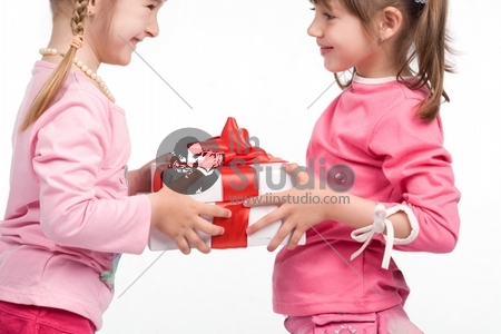 Little girls holding white gift boxes