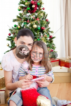 Happy mother and daughter at home at Christmas