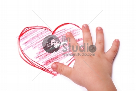 The children's hand is located in heart drawing, isolated