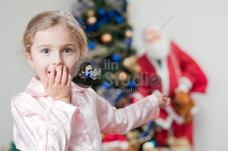 Surprised little girl - Santa Claus is coming