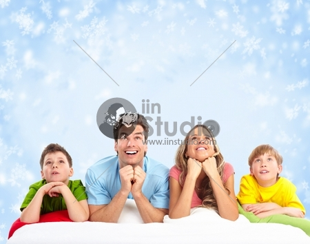 Happy family over winter snowflake background
