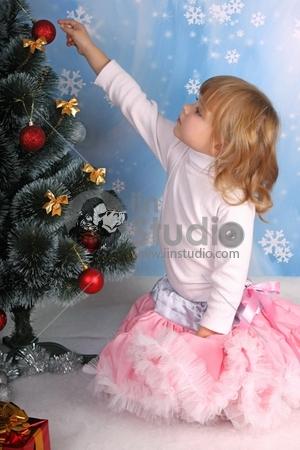 cute girl in a lush tree skirt dresses