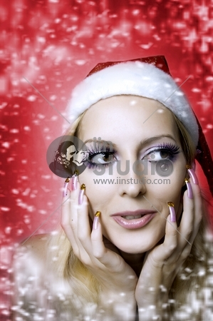 Christmas bright make-up and long nails manicure concept