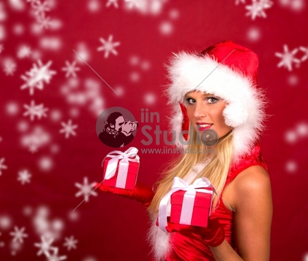 Beautiful blond girl portrait in santa costume with blur snowy background