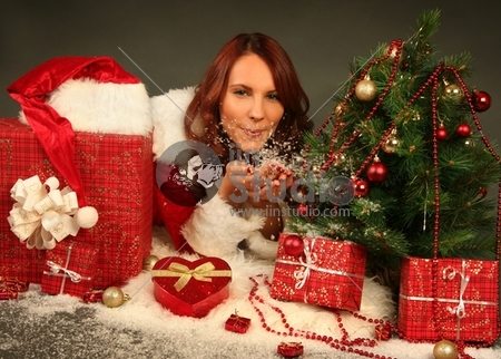 beautiful Santa girl with christmas presents