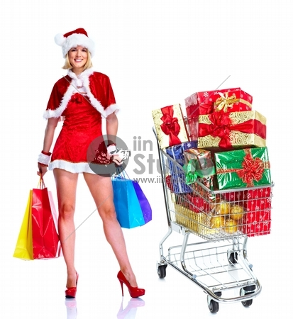 Sexy santa helper woman with a shopping cart