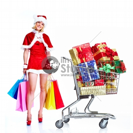 Sexy santa helper woman with a shopping cart