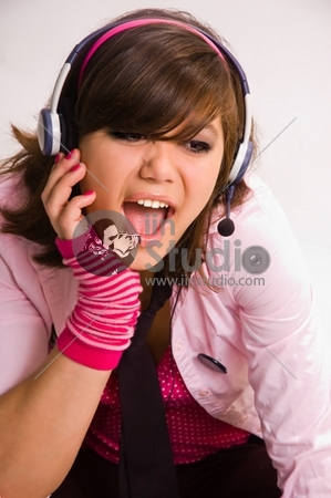 The singing girl in headphones