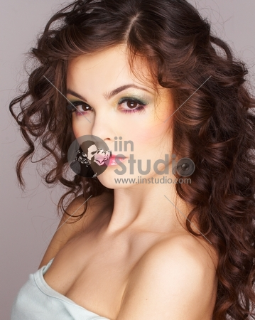 Portrait of sexy woman with beautiful make-up and long curly hair
