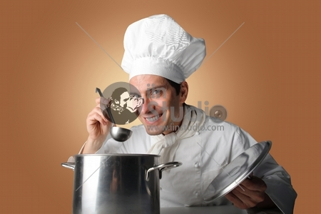 portrait of a cook tasting a soup in a pot
