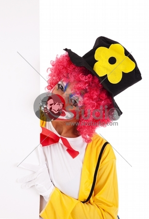 clown holding and looking to a blank banner (isolated on white)
