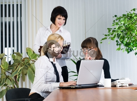 Businesswoman giving a presentation to her team in office