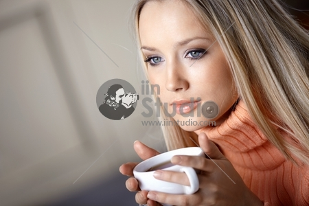 The attractive young girl with a cup close up
